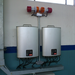 Control Units, DC1: Mounted on wall with alarms installed above
